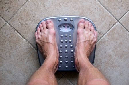 weighing scale: Feet on a weighing scale