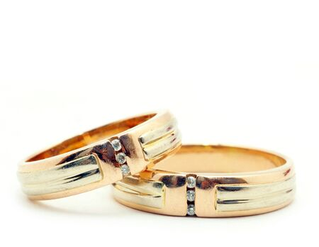 Gold wedding rings isolated on white background photo
