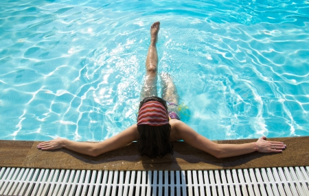 jacuzzi: young woman sitting in swimming pool