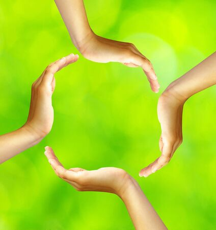 ring of hands isolated on a green photo