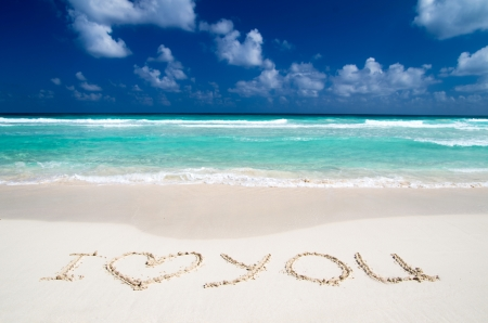Words I Love You on beach. vacation concept background photo