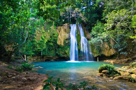 waterfall in deep green forest Stock Photo