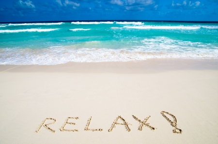 Word Relax on sand beach   photo