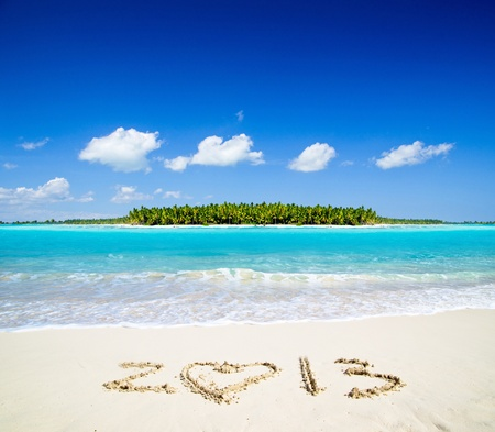 2013 on beach - concept holiday background photo