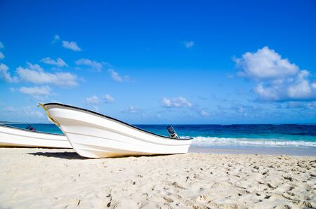 Boat on the  tropical beach photo
