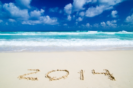 2014 year on the sand beach near the ocean Stock Photo