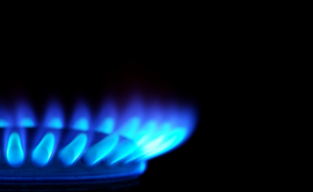 Blue flames of gas stove in the dark          Stock Photo - 25229737