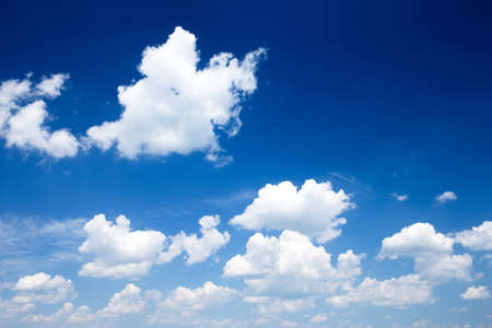 Blue sky background with a tiny clouds photo