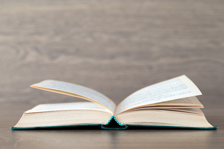 Open book on wood background photo