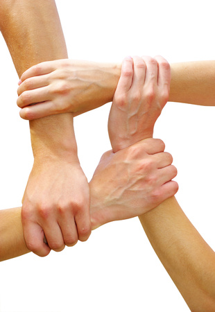linked hands: Linked hands on a white background symbolizing teamwork and friendship Stock Photo