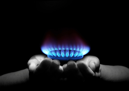 blue flame: Hands holding a flame gas
