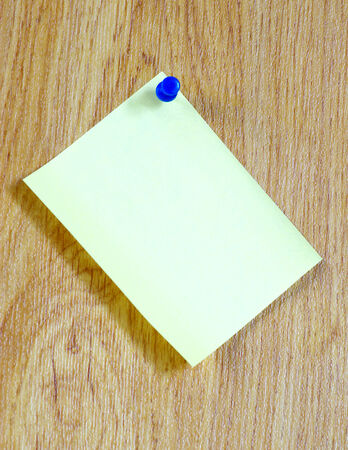 yellow tacks:  paper on wooden background.  for your message. Stock Photo