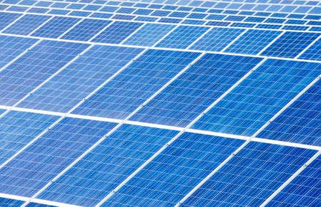 Solar energy panels against sunny sky photo