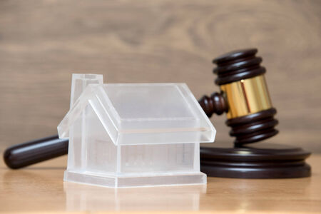 repossession: house model and a brown gavel Stock Photo