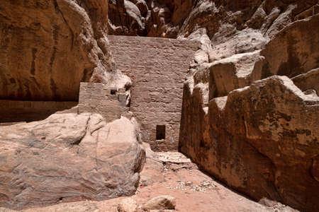 siq: The Siq, the narrow slot-canyon that serves as the entrance passage to the hidden city of Petra, Jordan,