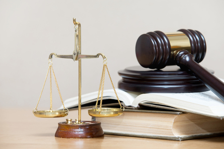 wooden gavel and books on wooden table