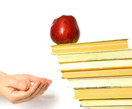 Red apple and stack of books for school photo