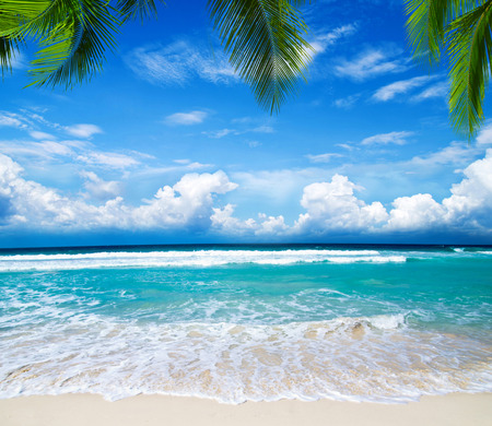 welcome written in a sandy tropical beach Stock Photo - 34138948