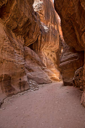 siq: The Siq, the narrow slot-canyon that serves as the entrance passage to the hidden city of Petra, Jordan,