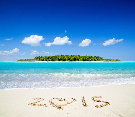 2015 on beach - concept holiday background photo