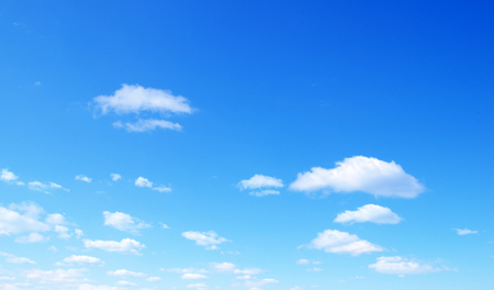 sunny sky: blue sky with tiny clouds