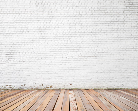 white brick wall and wood floor background Standard-Bild