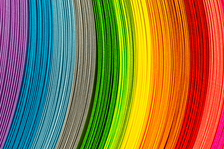 color effect: Paper strips in rainbow colors as a colorful backdrop
