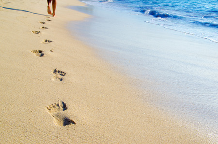 beach feet: Footprints in wet sand of beach
