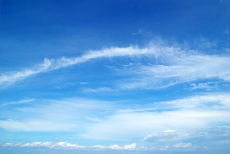sky blue: Blue sky background with tiny clouds