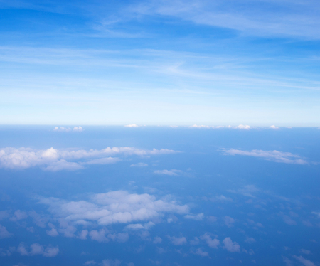 dispel: Blue sky background with tiny clouds