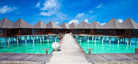 Bungalows water op de Malediven Stockfoto