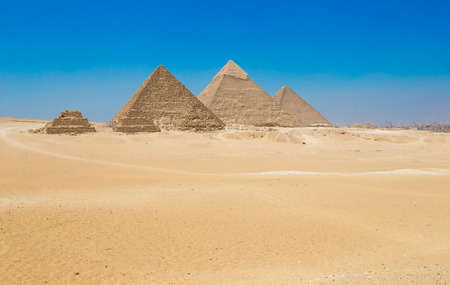 egyptian pyramids: pyramids with a beautiful sky of Giza in Cairo, Egypt.