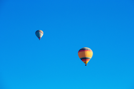 adventure aeronautical: Colorful hot air balloons flying over the valley at Cappadocia, Anatolia, Turkey. Stock Photo