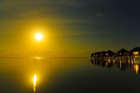 maldives island: Sunset on Maldives island, water villas resort Editorial
