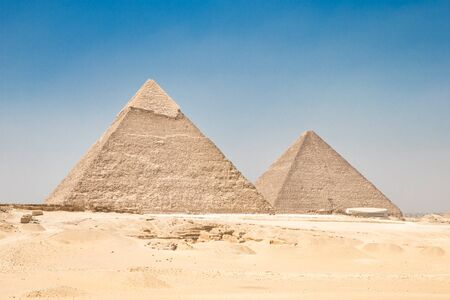 saddle camel: pyramids with a beautiful sky of Giza in Cairo, Egypt.