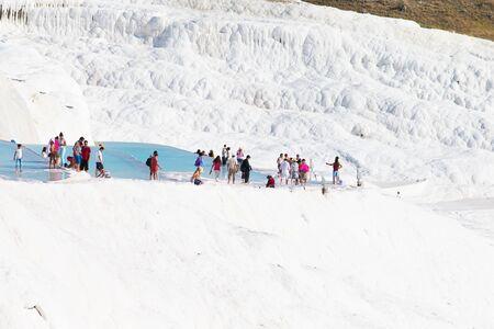 pamuk: Pamukkale, Turkey - August, 14 2015: Tourists on Pamukkale Travertine pools and terraces.  Editorial