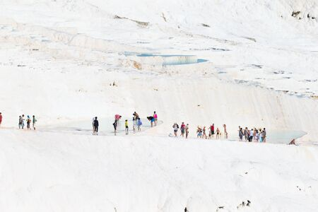 pamuk: Pamukkale, Turkey - August, 14 2015: Tourists on Pamukkale Travertine pools and terraces