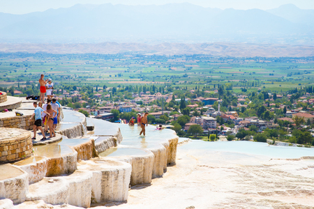 pamuk: Pamukkale, Turkey - August, 14 2015: Tourists on Pamukkale Travertine pools and terraces.  Editorial