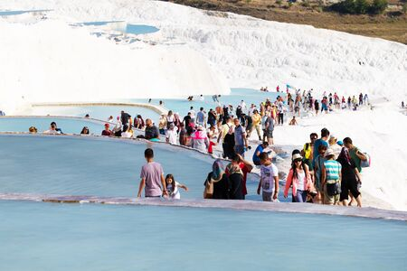 pamuk: Pamukkale, Turkey - August, 14 2015: Tourists on Pamukkale Travertine pools and terraces. Pamukkale is famous UNESCO world heritage site in Turkey Editorial