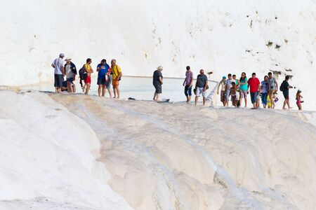 hierapolis: Pamukkale, Turkey - August, 14 2015: Tourists on Pamukkale Travertine pools and terraces.