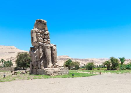 iii: Egypt. Luxor. The Colossi of Memnon - two massive stone statues of Pharaoh Amenhotep III