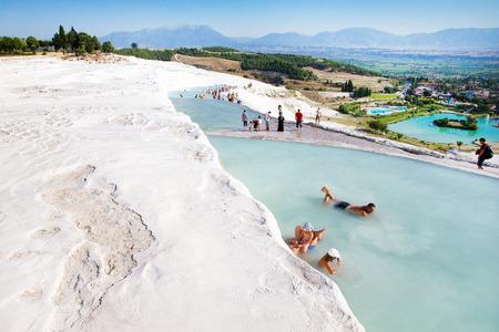 pamuk: Pamukkale, Turkey - August, 14 2015: Tourists on Pamukkale Travertine pools and terraces. Pamukkale is famous UNESCO world heritage site in Turkey Editorial