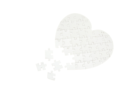 broken unity: Incomplete jigsaw puzzle in a shape of a heart isolated on white