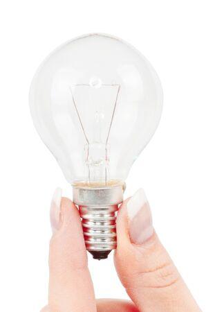 lit: Lit lightbulb held in hand