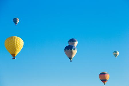 adventure aeronautical: Colorful hot air balloons flying over the valley at Cappadocia Stock Photo