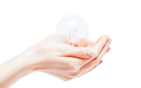 Lit lightbulb held in hand