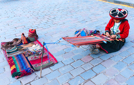 handcrafted: Peru Nov. 9 2015: Unidentified native weavers, dressed in traditional clothing, demonstrate their handicraft. Cusco.