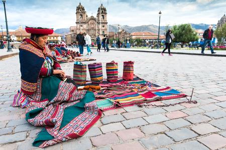 Peru Nov. 9 2015: Unidentified native weavers, dressed in traditional clothing, demonstrate their handicraft. Cusco.