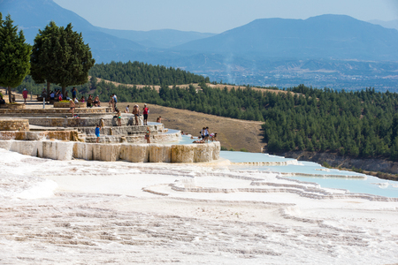 Pamukkale, Turkey - August, 14 2015: Tourists on Pamukkale Travertine pools and terraces.