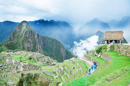 MACHU PICCHU NOVEMBER 11: Tourists walk in Machu Picchu site on November 11 2015 in Machu Picchu. Editorial